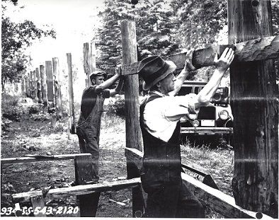 1937, WPA setting fence posts